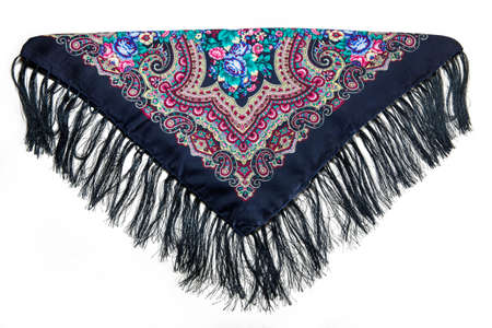 top view on folded black cotton scarf with fringe and colorful floral ornament with paisley print isolated on white background