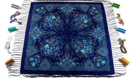 top view on blue cotton scarf with fringe, bright floral ornament, and different accessories flat lay on white background 写真素材