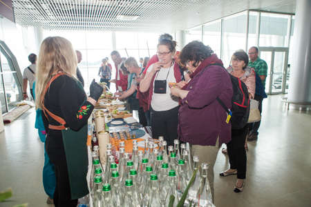 different passengers take part in free alcohol degustation in Lviv international airport