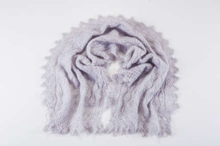 top view on folded handmade gray woolen scarf with knitted pattern in russian old style on light gray background 写真素材