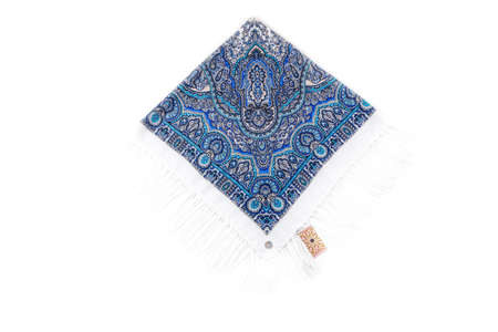 top view on flat blue cotton scarf with fringe and bright floral ornament 写真素材