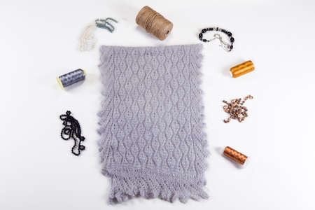 top view on folded handmade grey woolen scarf with knitted pattern