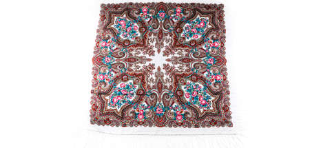 top view on flat white cotton scarf with fringe and bright floral ornament with golden, brown and yellow colors lay on white background