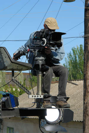 A cameraman sitting on the gibbet
