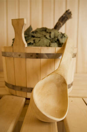 Wooden wash-tub with scoop in steam bath-room photo