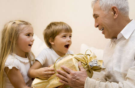 Children make a present to their grandpa   Stock Photo