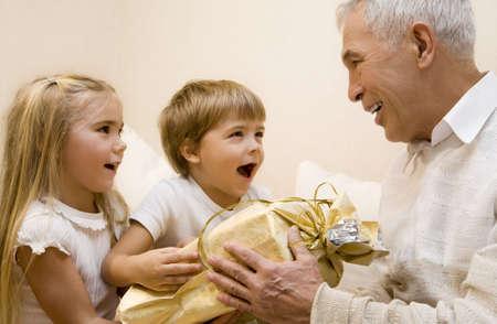 Children make a present to their grandpa Stock Photo - 2330588