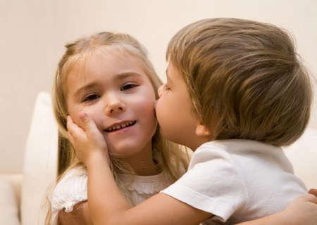 Little boy kiss his sister   photo