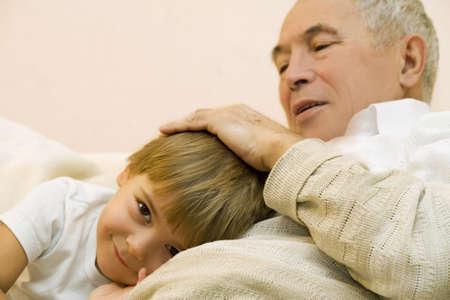 kindred: Grandpa stroke the head of his grandson   Stock Photo