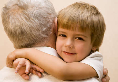 kindred: Little boy embrace his grandpa   Stock Photo