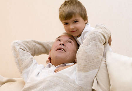 kindred: Adult senior play about with his grandchild 3   Stock Photo