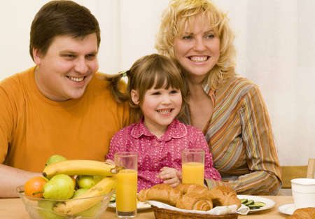 Happy family have a breakfast at the table   Stock Photo
