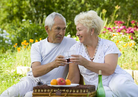 Mature couple picnicked on the grass