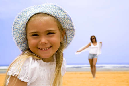 Portrait of daughter with mother on the beach   photo