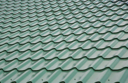 View of the roof covered by green tile photo