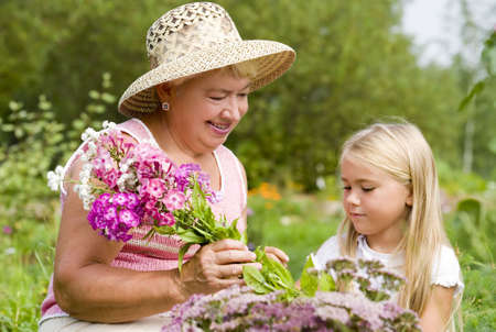 Grandma and her grandchild have a rest in the park   Stock Photo