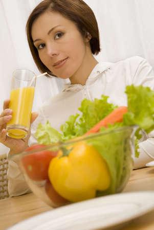 Young girl is drinking orange juice