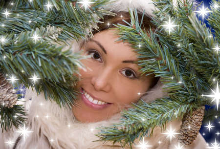 Portrait of young pretty woman in pine branches  photo