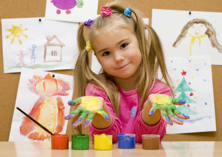 Little girl shows her painted hands  photo