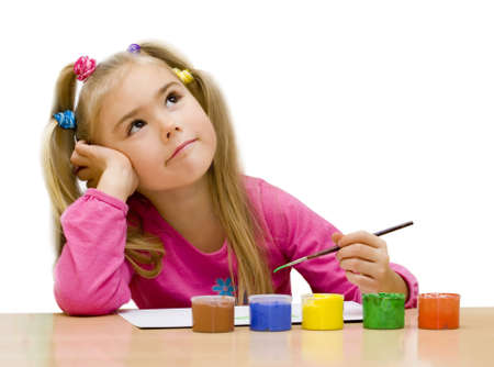 Little painter thinks of a new picture. Your text over white. Stock Photo - 3888253