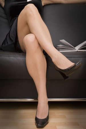 Women legs wearing black shoes