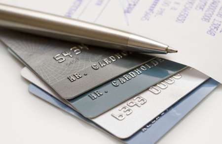 Pile of credit cards with pen and bill. Narrow focus Stock Photo - 4067393