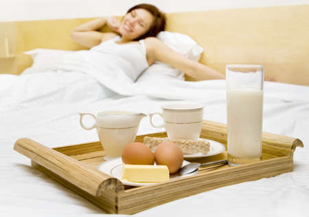Young woman has a breakfast in the bed  photo