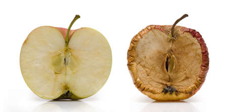 Two half of apple over white. Fresh and slice in decay. Stock Photo