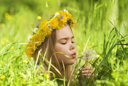 Portrait of a little girl in the grass    Stock Photo