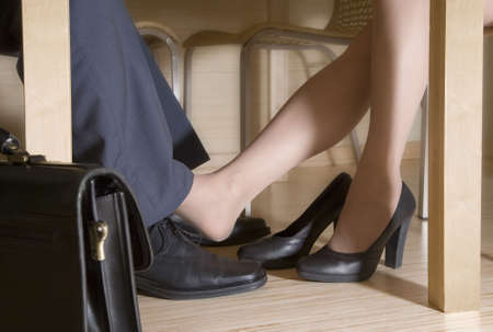 Man and woman flirting while a business meeting photo