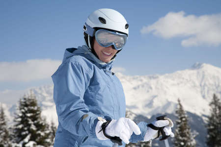 Young woman with ski against mountains photo