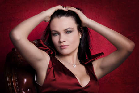 Portrait of an elegantly beautiful young woman over red Stock Photo - 6721395