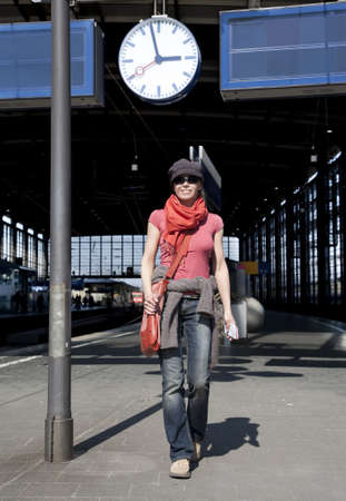 Young woman is waiting for the train  photo