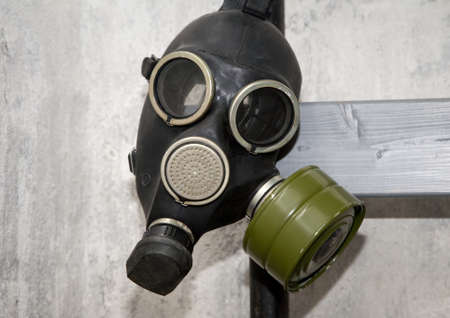 Old-fashioned gas mask of Cold War period photo