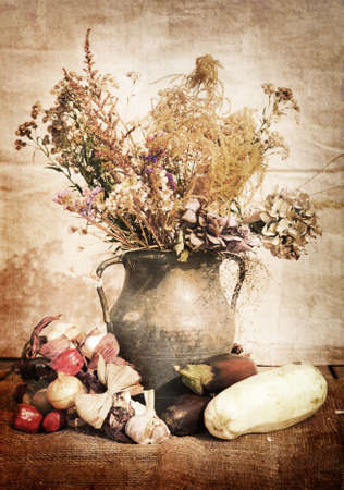 antique vase: still life of a flowers in a vase with vegetables
