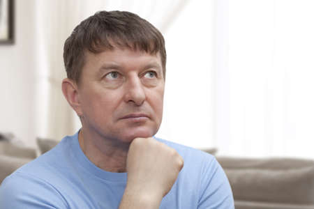 Portrait of elderly man lost in thought  photo