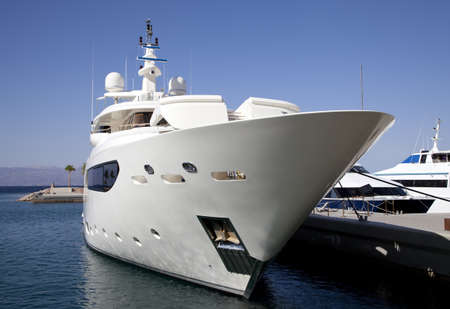bow of boat: Large private luxury yacht moored in marina  Stock Photo