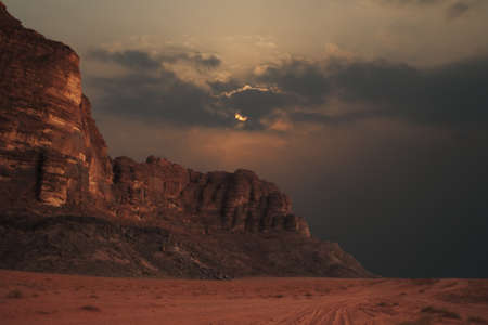 Sun being obscured by clouds in Wadi Rum, Jordan