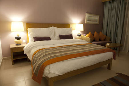 kingsize: Well decorated hotel bedroom in soft lights