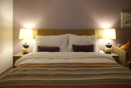 Well decorated hotel bedroom in soft lights   photo