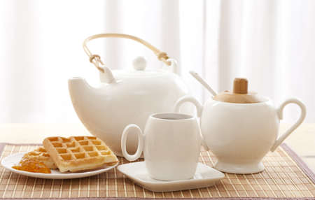 morning tea: Tea set including a teacup, a teapot and a sugar bowl  Stock Photo