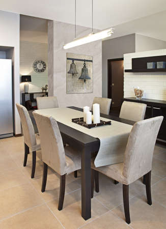 dining table and chairs: Vertical shot of a modern dining room