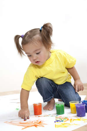 smudgy: Cute baby girl painting with a finger
