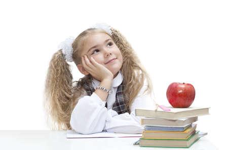 schoolgirls: Portrait of schoolgirl dreaming instead of making her homework