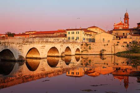 Historical roman Tiberius bridge over Marecchia river, Rimini, Italy