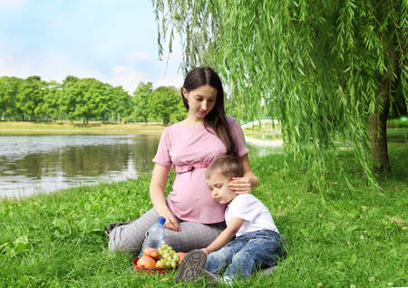 Mother and son having picnic on summer sunny day  photo