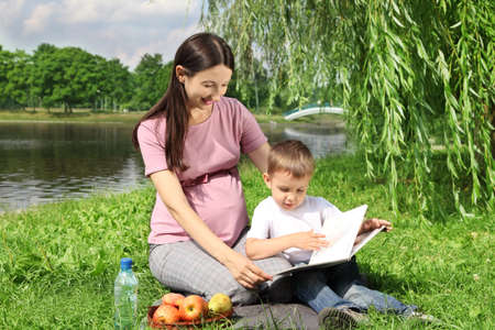 Mother reading picture book to her child Stock Photo - 10417694
