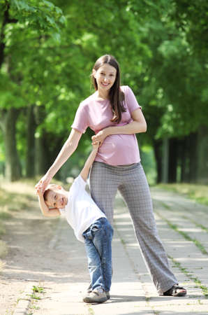 Mother and son walking. photo
