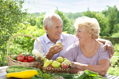 Happy elderly couple with this years rich harvest