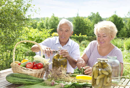 mature adults: Mature couple making home made pickles